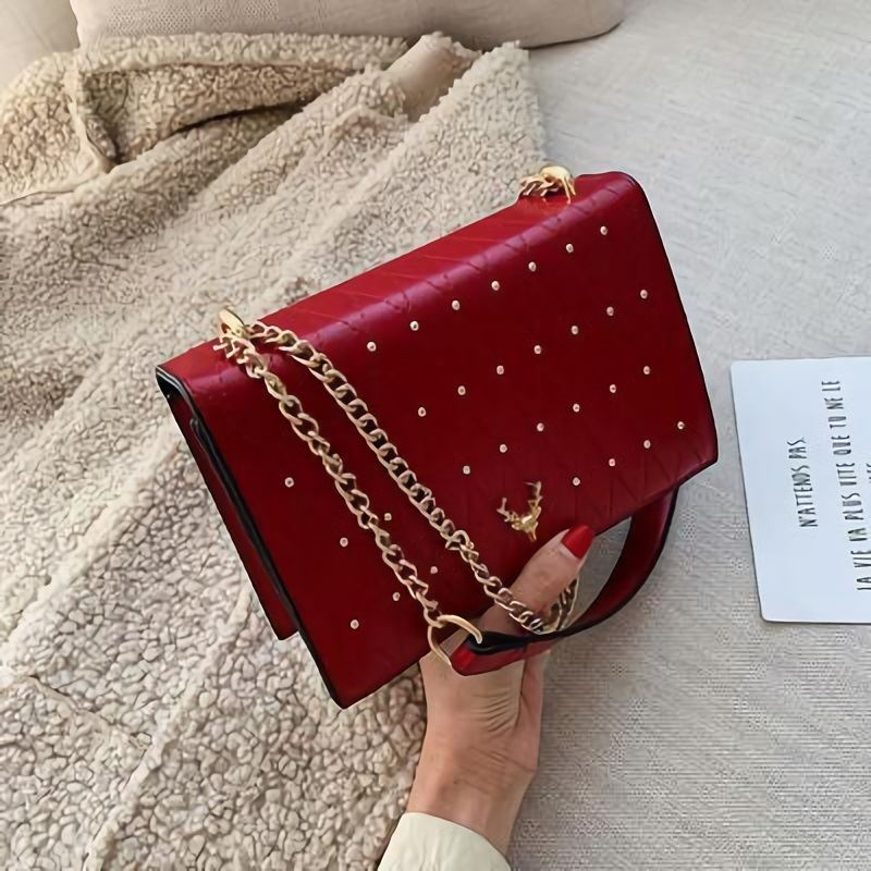B125492 JKT IDR.173.000 MATERIAL PU SIZE L21.5XH15XW7CM WEIGHT 600GR COLOR RED