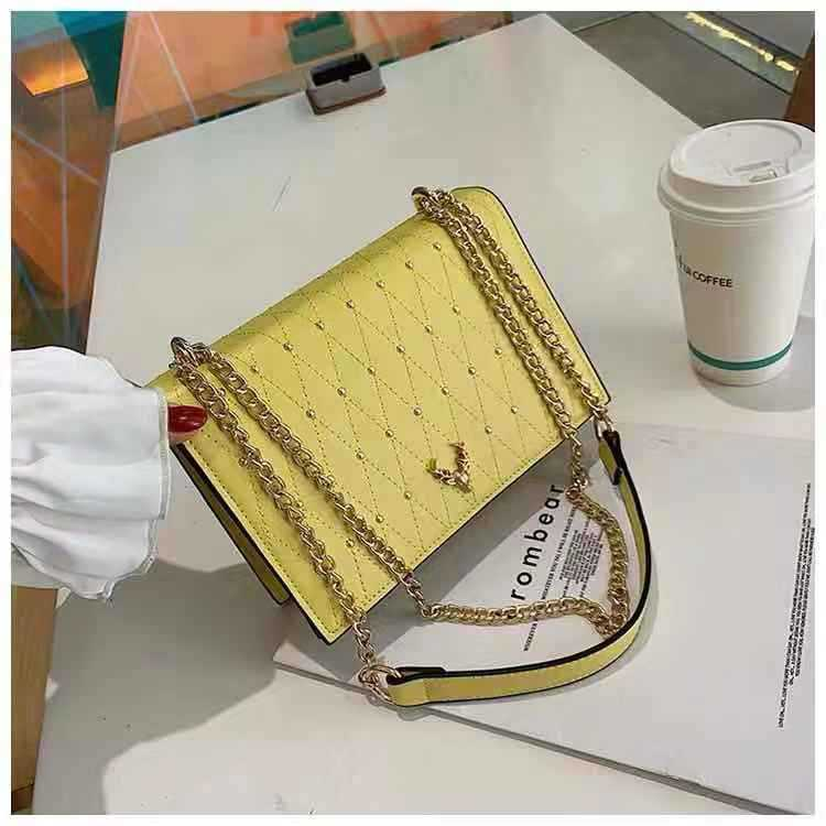 B125492 JKT IDR.173.000 MATERIAL PU SIZE L21.5XH15XW7CM WEIGHT 600GR COLOR YELLOW