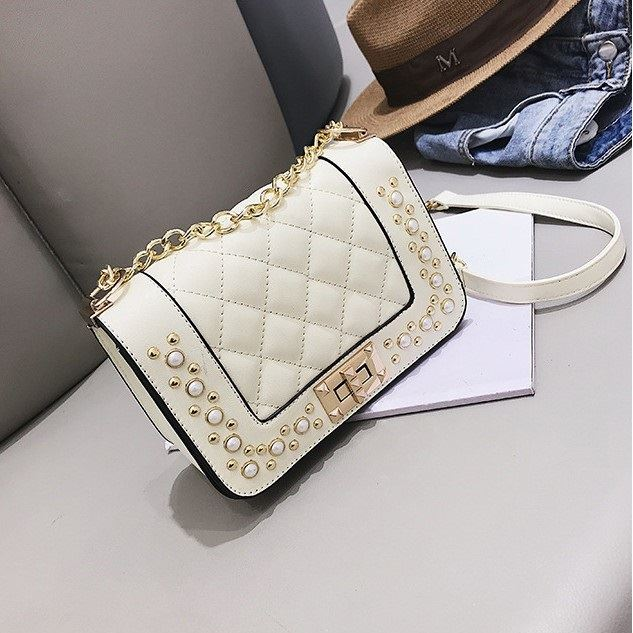 B1930 JKT IDR.151.000 MATERIAL PU SIZE L19.5XH13XW9CM WEIGHT 550GR COLOR BEIGE