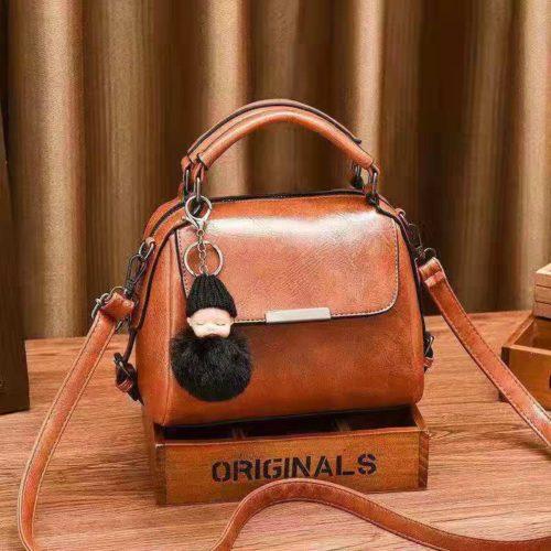B8160-brown Tas Selempang Cantik Gantungan Baby Pom Pom