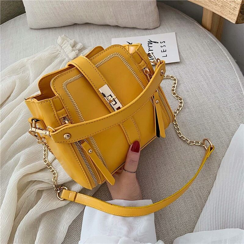 B9309 JKT IDR.178.000 MATERIAL PU SIZE L19XH17XW11CM WEIGHT 500GR COLOR YELLOW