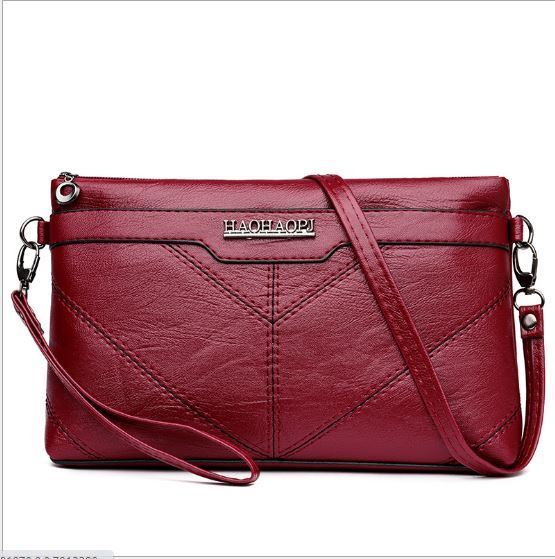 JT00205 IDR.141.000 MATERIAL PU SIZE L25XH15XW5CM WEIGHT 300GR COLOR RED
