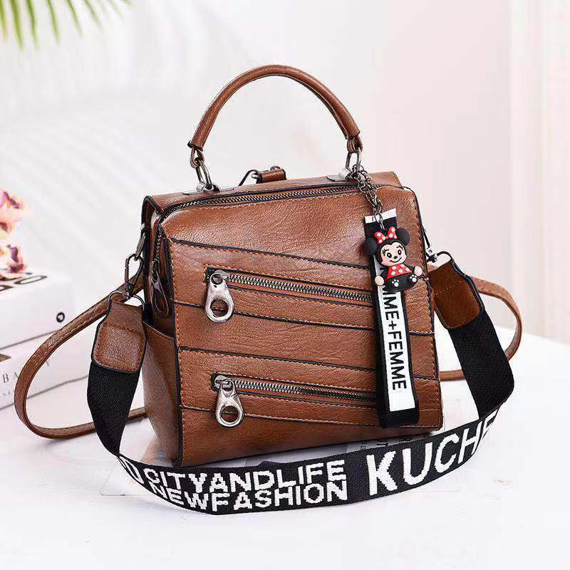 JT003 IDR.172.000 MATERIAL PU SIZE L21XH20XW13CM WEIGHT 750GR COLOR DARKBROWN