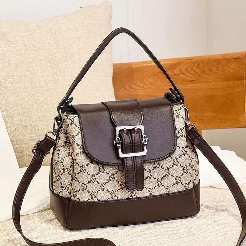 JT0216 IDR.180.000 MATERIAL PU SIZE L23XH19XW11CM WEIGHT 650GR COLOR COFFEEWZ