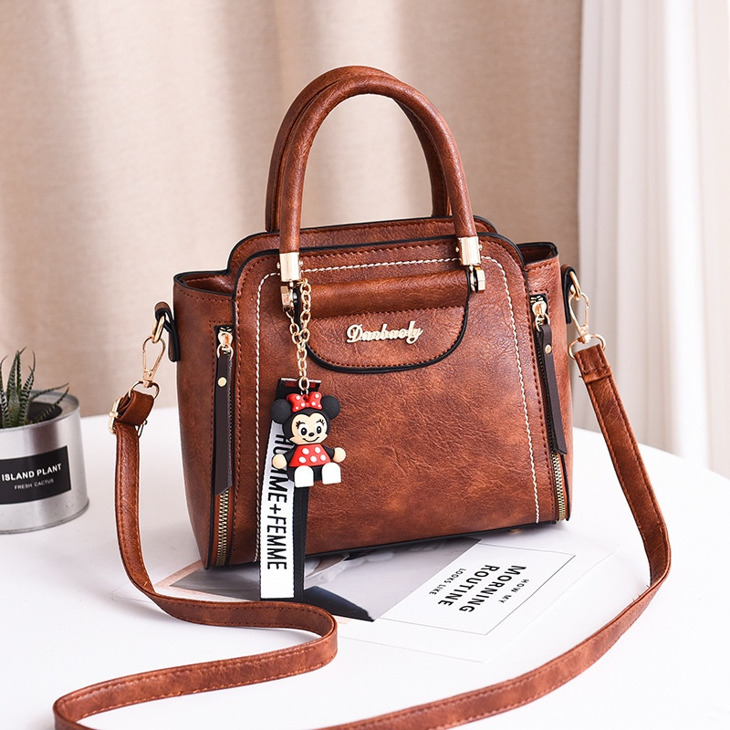 JT1816 IDR.169.000 MATERIAL PU SIZE WEIGHT COLOR BROWN