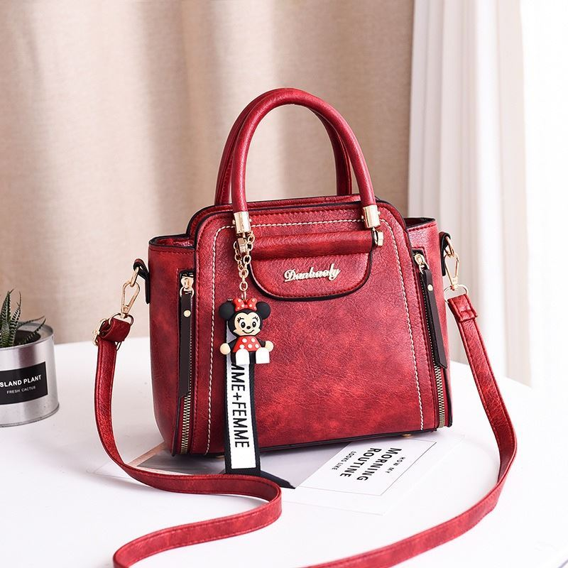 JT1816 IDR.170.000 MATERIAL PU SIZE L24XH20XW10CM WEIGHT 750GR COLOR WINE