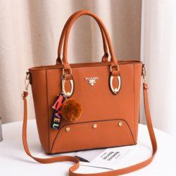 JT2040-brown Tas Handbag Pom Pom Elegan Import