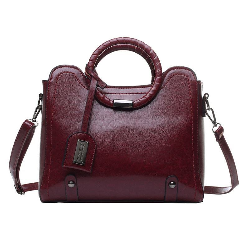 JT30352 IDR.165.000 MATERIAL PU SIZE L28XH23.5XW13CM WEIGHT 750GR COLOR WINE