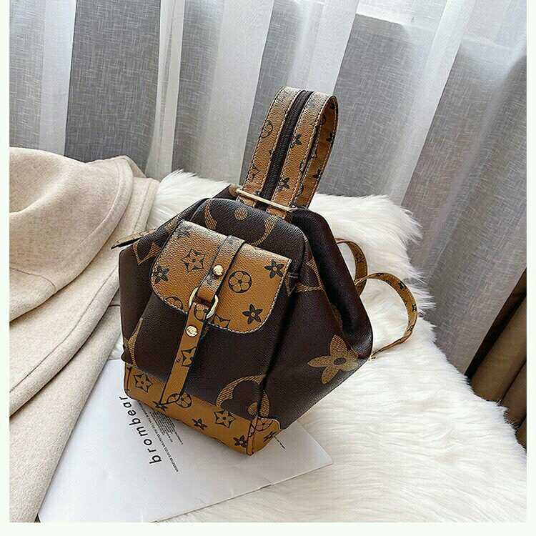 JT31344 IDR.174.000 MATERIAL PU SIZE L24XH26XW13CM WEIGHT 450GR COLOR COFFEE