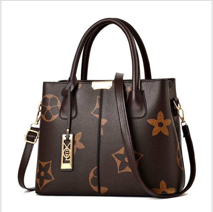 JT3226 IDR.173.000 MATERIAL PU SIZE L31XH23XW13CM WEIGHT 550GR COLOR COFFEE