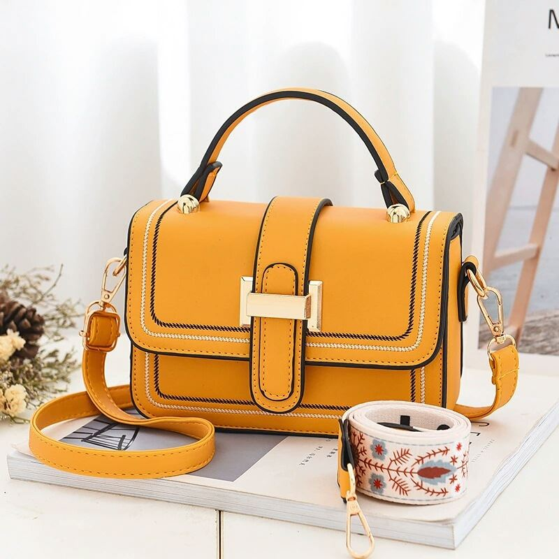 JT5955 IDR.172.000 MATERIAL PU SIZE L19XH13XW6CM WEIGHT 550GR COLOR YELLOW