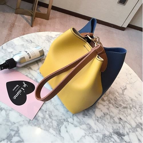 JT8028 IDR.125.000 MATERIAL PU SIZE L17XH18XW12CM WEIGHT 400GR COLOR YELLOWBLUE