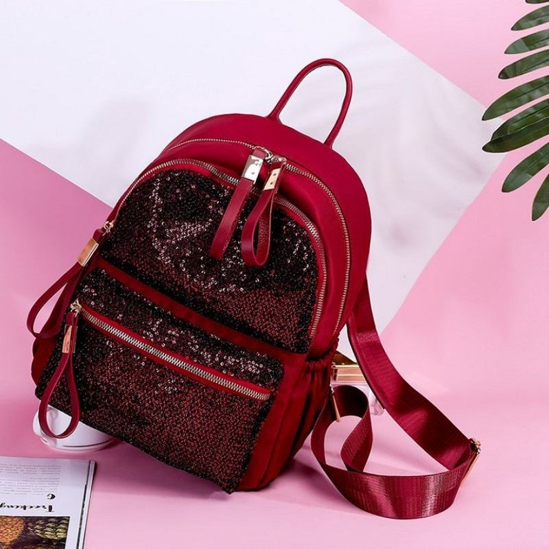 JT813479 IDR.162.000 MATERIAL OXFORD SIZE L26XH30XW15CM WEGHT 520GR COLOR REDSEQUIN