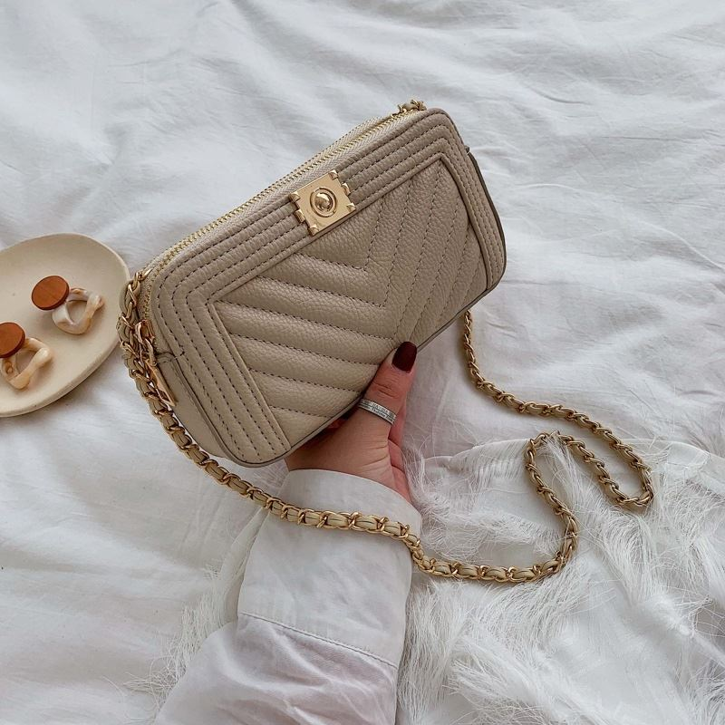 JT992234 IDR.160.000 MATERIAL PU SIZE L21XH11XW5CM WEIGHT 300GR COLOR KHAKI
