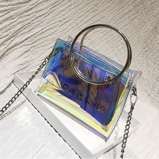 JTF10239 (2IN1) IDR.33.000 MATERIAL PU+TRANSPARENT SIZE L17XH12XW7CM WEIGHT 250GR COLOR LASERSILVER