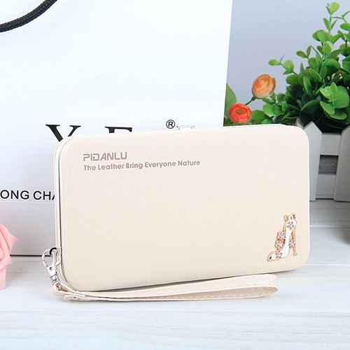 JTF1311 IDR.29.000 MATERIAL PU SIZE L18.5XH10.5XW2.8CM WEIGHT 250GR COLOR BEIGE
