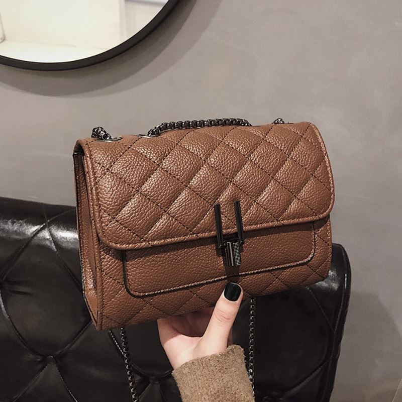 JTF2644 IDR.80.000 MATERIAL PU SIZE L20.5XH14.5XW8CM WEIGHT 500GR COLOR COFFEE