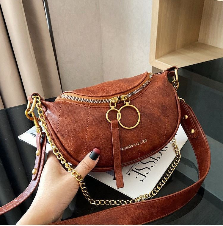 JTF30337 IDR.72.000  MATERIAL PU SIZE L15XH14XW6CM WEIGHT 350GR COLOR BROWN