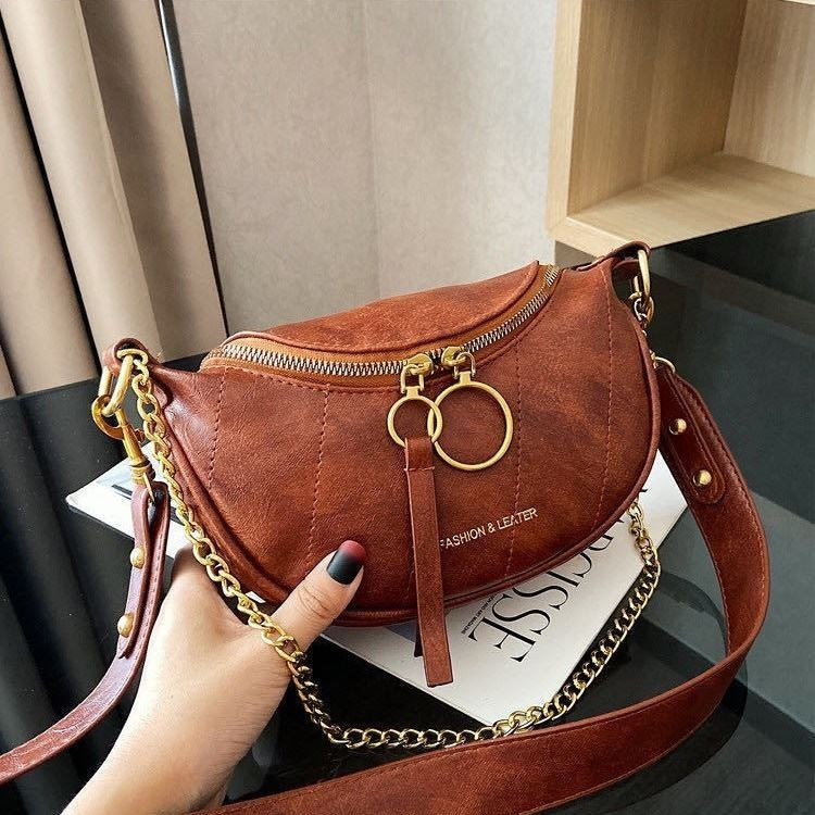 JTF30337 IDR.73.000  MATERIAL PU SIZE L15XH14XW6CM WEIGHT 350GR COLOR BROWN