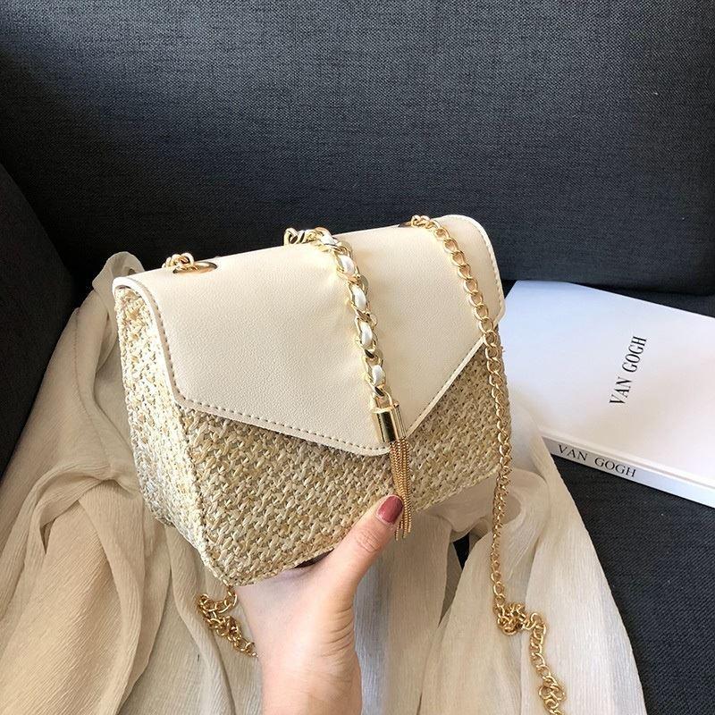 JTF3148 IDR.59.000 MATERIAL PU+STRAW SIZE L19XH15XW8CM WEIGHT 450GR COLOR BEIGE