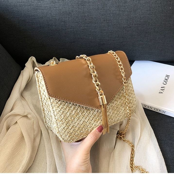 JTF3148 IDR.59.000 MATERIAL PU+STRAW SIZE L19XH15XW8CM WEIGHT 450GR COLOR BROWN