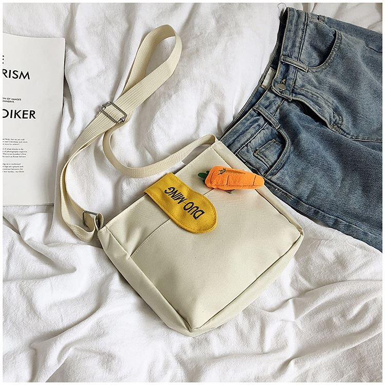 JTF607 IDR.28.000 MATERIAL CANVAS SIZE L21XH20XW6CM WEIGHT 150GR COLOR BEIGE