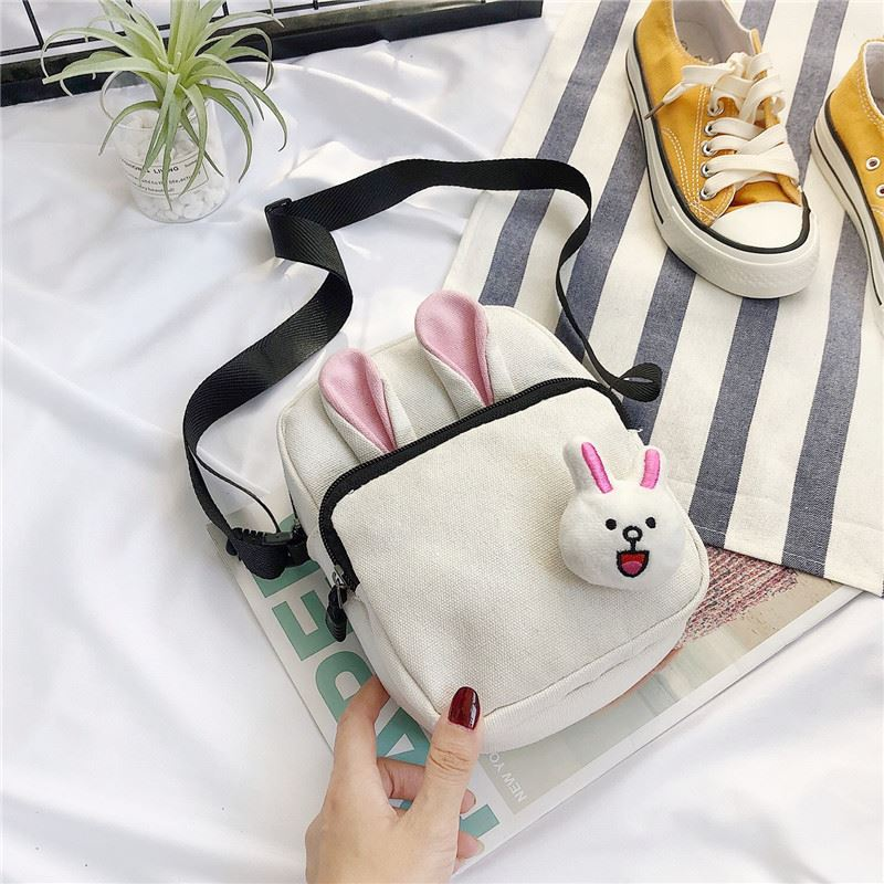 JTF7398 IDR.33.000 MATERIAL CANVAS SIZE L15XH20X6CM WEIGHT 100GR COLOR BEIGE