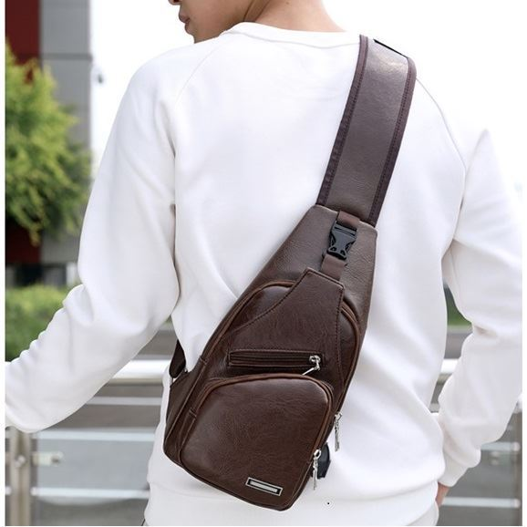 JTF8029 IDR.35.000 MATERIAL PU SIZE L17XH35XW6CM WEIGHT 350GR COLOR DARKBROWN