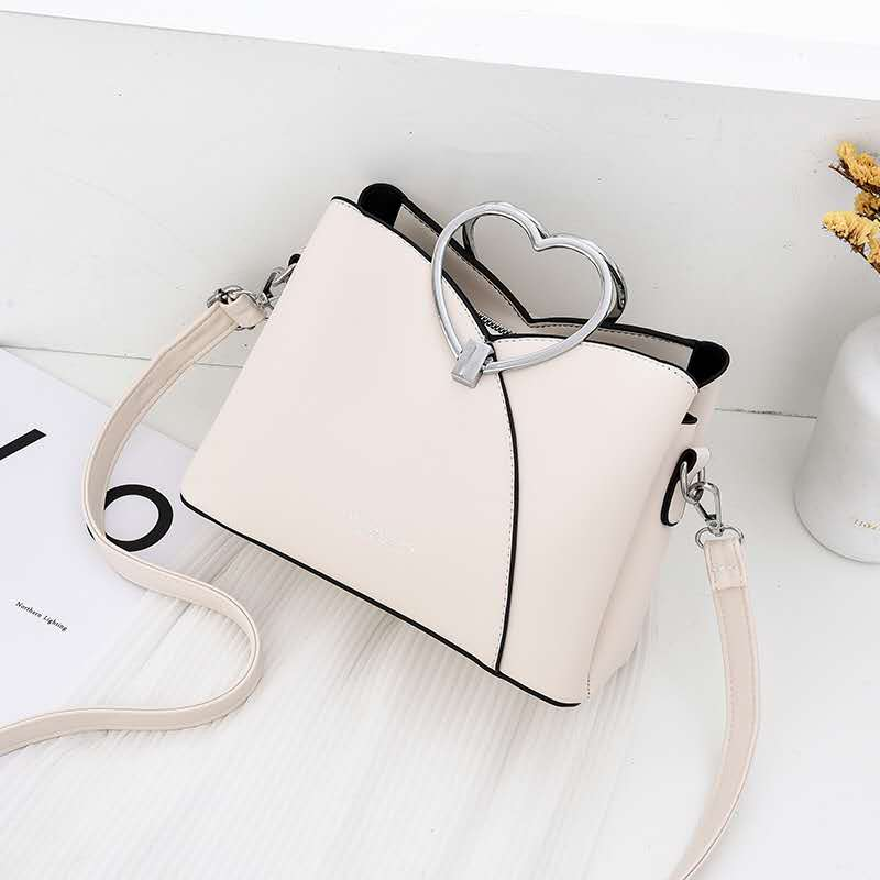 JTF8071 IDR.94.000 MATERIAL PU SIZE L23XH18XW11CM WEIGHT 600GR COLOR BEIGE