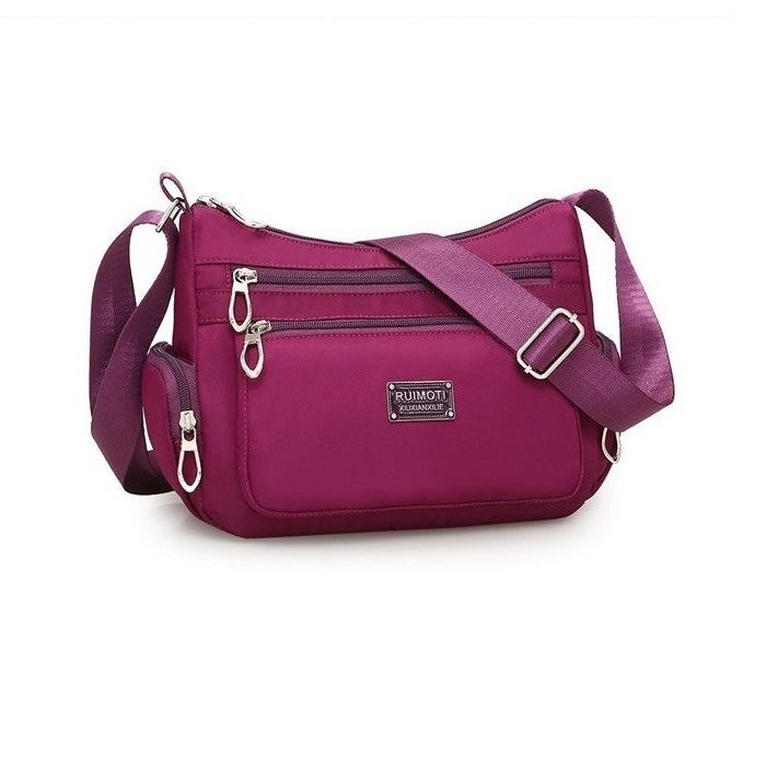 JTF8890 IDR.55.000 MATERIAL NYLON SIZE L26XH18.5XW10CM WEIGHT 400GR COLOR PURPLE