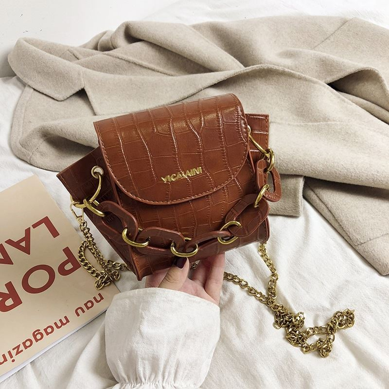 JTF9523 IDR.49.000 MATERIAL PU SIZE L15XH17XW7CM WEIGHT 350GR COLOR LIGHTBROWN